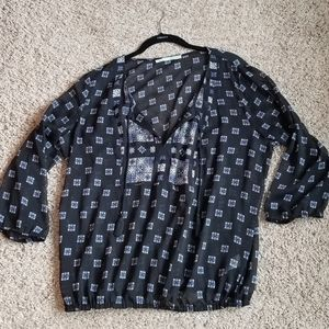 Light weight blouse. Would need a cami under it.
